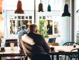 man in cafe by Jeff Sheldon - unsplash